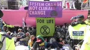 Police remove Extinction Rebellion protesters from pink boat on London's Oxford Street [Video]