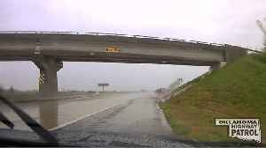 State Trooper's Dashcam Captures Car Spinning Out on Wet Oklahoma Highway [Video]