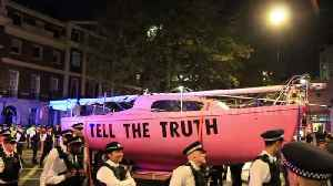 Police tow away pink ship during 'Extinction Rebellion' protest [Video]