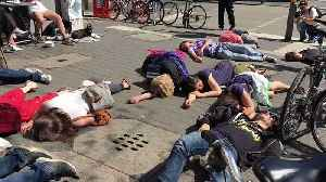 Extinction Rebellion Protesters Stage 'Die-In' in Cologne [Video]