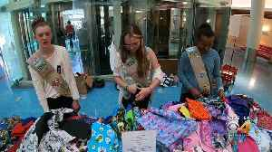 Girl Scouts Design, Sew, Distribute Capes To Patients [Video]