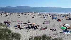 Hotter than Spain! Rare Easter heatwave packs Wales beach [Video]