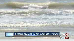 Five swimmers rescued from rip current [Video]