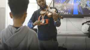 Music Teacher Heathcliff Sygapolho Gives Free Violin Lessons To Children [Video]