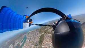 Dizzying Footage Shows Wingsuit Pilot Struggle To Unhook Parachute After It Gets Tangled On Descent [Video]