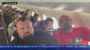 Body Builders Crammed On Plane [Video]