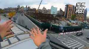 Subway Spider-man runs along the top of a moving train [Video]