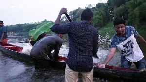 Indian couple end up falling into river trying to get perfect wedding photo [Video]