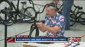 Volunteers take part in bicycle build party [Video]