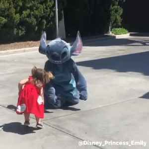 Disney's Stitch 'Falls' in Solidarity With Tiny Fan Who Tripped While Running to Meet Him [Video]