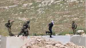 Israeli Soldiers Reportedly Shoot & Wound An Unarmed, Handcuffed Palestinian [Video]