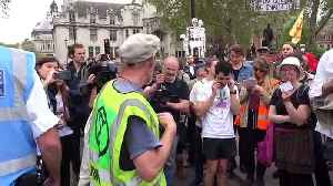 Extinction Rebellion crowd repeat instructions in bizarre call and response [Video]