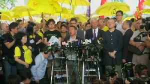 Hong Kong 'Occupy' leaders arrive for sentencing; four jailed for democracy protests [Video]