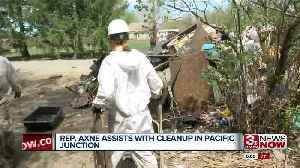 Rep. Cindy Axne helps clean up efforts in Pacific Junction [Video]
