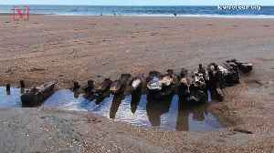 Tide Uncovers Remains of 100-Year-Old Shipwreck on Shore [Video]
