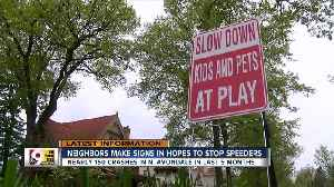 Neighbors make signs to slow speeders [Video]