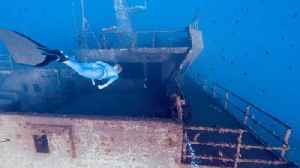 Stunning Footage Captures Freediver Swimming Across Shipwreck [Video]