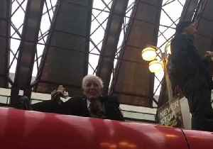 83-Year-Old Climate Change Protester Enjoys Sandwich Atop Grounded Train [Video]