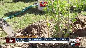 Father teaches students hot to plant fruit trees [Video]
