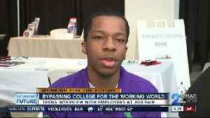 Students interview with employers at job fairs [Video]