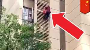Chinese granny Spiderverses down high rise apartment [Video]
