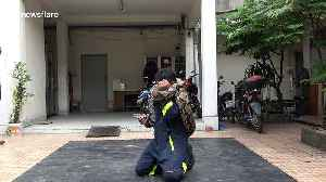 Brave Thai fireman shows how to escape a deadly python attack [Video]