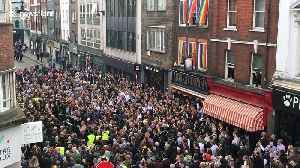 Homophobic nail-bomb attack remembered by defiant crowd-rousing street choir [Video]
