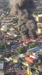 2 Large Fires Seen Burning Simultaneously From Vantage Point of Metro Manila Tower Block [Video]