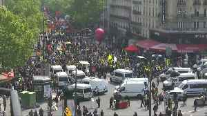 Protesters shake van and dodge tear gas at Paris May Day rally [Video]
