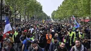 Riot Police And Masked Protesters Clash In Paris [Video]