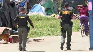 Dozens of Homeless Ordered to Leave Encampment in Sacramento; Advocates Face Off with Law Enforcement [Video]