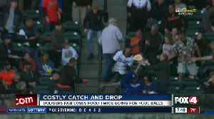 Fan drops food TWICE to catch foul balls at baseball game [Video]