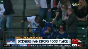 Dodgers fan drops food twice [Video]