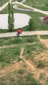 Guy Faces Fall Riding His Bike Down Uneven Hill [Video]