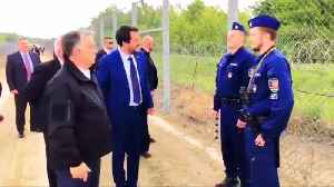 Orban, Salvini inspect border fence which keeps migrants away from EU [Video]
