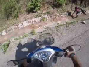 Biker Trying to High Five Biker Friend Falls in Ditch [Video]