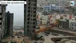 Crane topples on building; bus blown away: Cyclone Fani destruction on cam [Video]