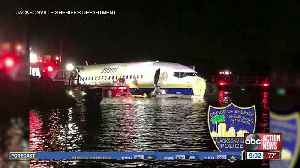 Large jet skids into a river in Florida with 142 on board [Video]