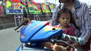 Too cute! Girl rides motorscooter with pet baby civet [Video]