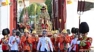Thailand's New King Carried Through Street By 16 Men [Video]