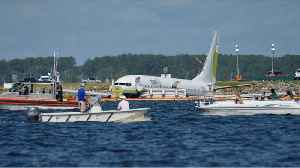 Investigation begins into Boeing 737 that slid off runway into river [Video]