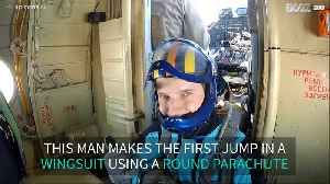 Man makes first wingsuit jump with round parachute [Video]