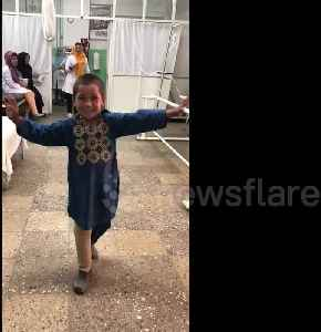 Afghan boy who lost leg to landmine dances for joy with new prosthetic limb [Video]