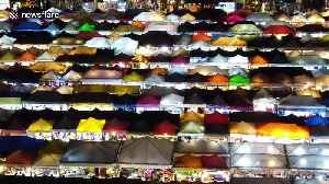 Stunning view of multi-coloured market stall roofs becomes popular selfie destination in Thailand [Video]