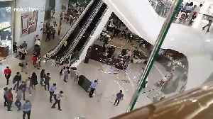 Debris plunges from fifth floor escalator as heavy rain batters Philippines shopping mall [Video]