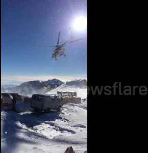 Russian power workers help build pylons at over 10,000-foot altitude [Video]