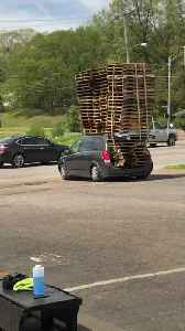 Tiny Car Transports Tower of Pallets [Video]