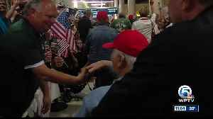 Hundreds gather at PBIA to welcome home veterans [Video]