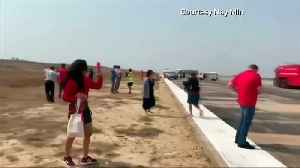 Myanmar plane makes emergency landing without front wheel [Video]