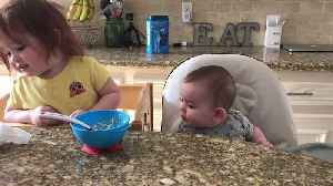 Little Girl Adorably Feeds Baby Brother Spoonfuls of Oatmeal [Video]